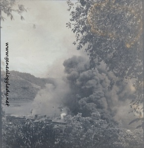 The ship burning after it was bombed (Photograph by Eugene McGraw)