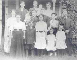 Photograph taken at the house of George F. Yegerlehner/Yagerline on Grace Street. Back Row: Unknown male (possibly Robert C. Yagerline), Mr. Van Sickle holding Charlotte, Mrs. Van Sickle Middle Row: Jewell (Ratcliffe) Yagerline, William O. Yagerline holding Dorothy, Floyd Van Sickle, Roberta (Yagerline) Van Sickle, George F. Yagerline Front Row: Elizabeth Louisa (Klein) Yagerline, Louis Yagerline, Hazel Yagerline, Margerite Yagerline, Laura Yagerline: Photograph from the collection of Hazel (Yagerline) Igelman in the possession of Eric Graham.