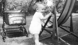 1943 - David playing with lawn chair